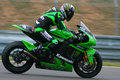 13 Rennend Team Anthony West - Kawasaki Stock Foto's