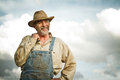 1930s farmer smiling at the Sun Royalty Free Stock Photo