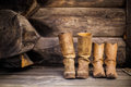2 Brown Leather Boots on Wooden Staircase
