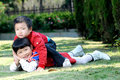2 children playing outdoors Royalty Free Stock Image