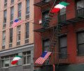 2 US and 2 Italian flags flying Royalty Free Stock Photo