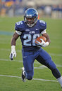 2011 NCAA football - Running back carries Royalty Free Stock Images