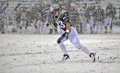 2011 NCAA Football - running in the snow Royalty Free Stock Photos