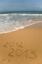 2012 and 2013 written in sand Stock Image