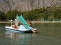 3 boat children pedal sea Royaltyfria Bilder