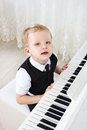 3-years pianist  play music Stock Image