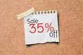 35% sale off promotion paper post on Cork Board Stock Photography