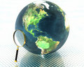 3D earth with magnifier Stock Photography