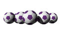 3D rendered purple soccer balls Royalty Free Stock Photography