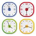 4 design clocks in 4 colors Stock Photography