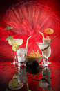 4 happy umbrella drinks on red Stock Images