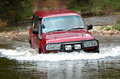 4WD Crossing River Stock Photo