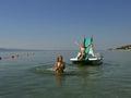 5 boat children pedal sea Arkivbild