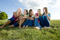5 Girls sitting together and laughing Stock Image