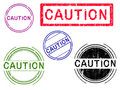 5 Grunge Stamps - CAUTION Royalty Free Stock Photo