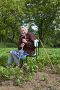82 years old woman working in field Stock Photo