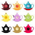 9 differently colored teapots with clocks Stock Photo