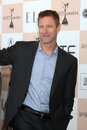 Aaron eckhart los angeles feb arrives at the film independent spirit awards at beach on february in santa monica ca Royalty Free Stock Photo