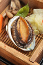 Abalone with vegetable on the dinner table Royalty Free Stock Photos