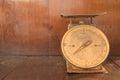 Abandon broken weight scales in orange wooden room Stock Photos