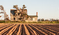 Abandon house behind a farmer s field in canada Royalty Free Stock Images