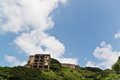 Abandon house in the hill with blue sky and cloud Royalty Free Stock Photos