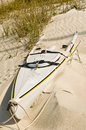 Abandon sea kayak on an isolated tropical beach covered with sand Stock Photo