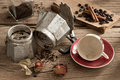 Abandon still life photography old and dirty espresso maker coffe cup coffee bean coffee grind cinnamon and dry rose in concept Stock Images