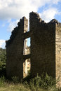 Abandon stone building under a cloudy blue sky Royalty Free Stock Image
