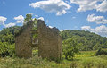 Abandon stone building under a cloudy blue sky Royalty Free Stock Photography