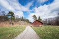 Abandoned barn beside a gravel road Royalty Free Stock Photo