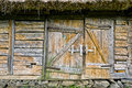Abandoned barn vintage wooden door. Photo of rustic house entrance Royalty Free Stock Photo