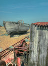 Abandoned boat hut and machinery andmachinary on the beach Stock Image