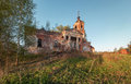 Abandoned brick orthodox church with a portico and columns at sunset Royalty Free Stock Photo