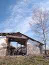 Abandoned building dilapidated barnyard spring landscape Stock Photography