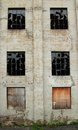Abandoned building facade of an full of broken windows and condamned windows Royalty Free Stock Photography
