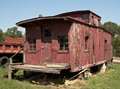 Abandoned caboose an old without wheels rots away Stock Photos