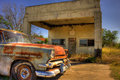 Abandoned car parked at abandoned gas station rusted vintage ford in front of an photographed somewhere on the back roads of texas Stock Image