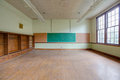 Abandoned classroom dusty ababdoned with bookshelf and chalk board Stock Photos