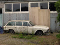 Abandoned dilapidated car in an unloved condition Royalty Free Stock Image