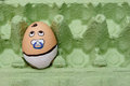 Abandoned Egg baby face in pampers Royalty Free Stock Photo