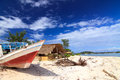 Abandoned fishing boat on a beach local gili meno lombok indonesia Stock Photo