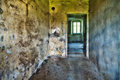 Abandoned hallway in hdr dirty run down empty old ruins high dynamic range photograph Royalty Free Stock Images