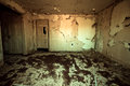 Abandoned home frightening room in with peeling paint Royalty Free Stock Photo