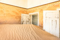 Abandoned house in the ghost town of Kolmanskop in Namibia Royalty Free Stock Photo