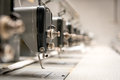 Abandoned industrial textile machines in a row factory sewing Stock Image