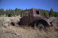 Abandoned jalopy an antique automobile in the mountains Stock Photo