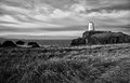 Abandoned lighthouse an on the small island of llanddwyn on the west coast of anglesey north wales the had it s five Royalty Free Stock Images