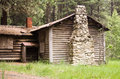 Abandoned log cabin in the woods Stock Image