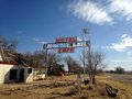 Abandoned motel an ghost in the city of glenrio new mexico sky blue skies and ancient roads make this photo a timeless Stock Image